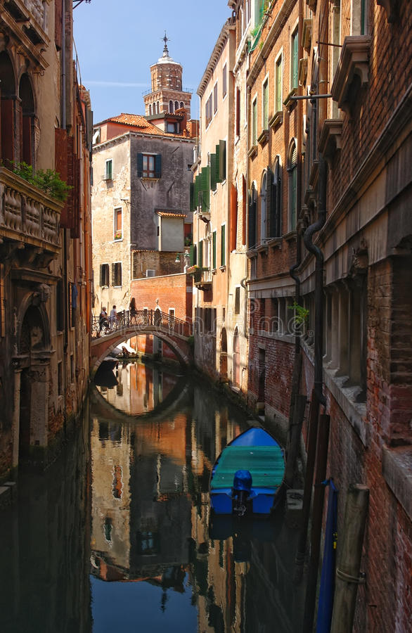 Scenic view of venetian canal with boat, Venice, Italy royalty free stock image