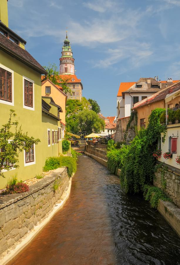 Scenic view of Vltava river betwwen old houses and castle tower on background in Cesky Krumlov, Czech Republic. UNESCO World Heritage Site stock photos