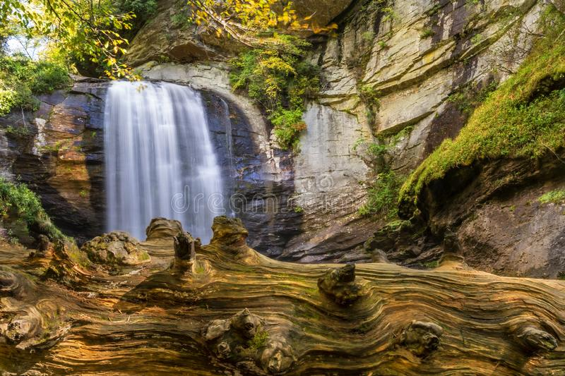 Scenic View Of A Waterfall Nestled In The Carolina Mountains. A waterfalls sits nestled in the Carolina mountains on an autumn day stock photo