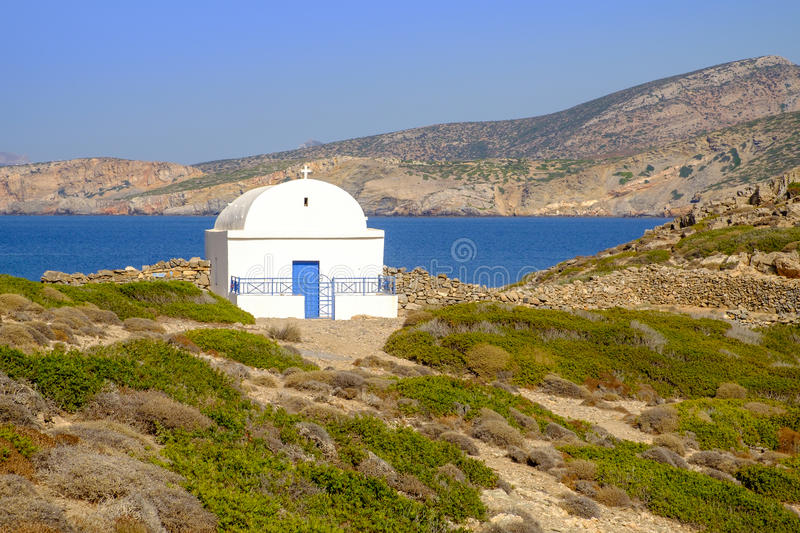 Scenic view of white chapel at beautiful ocean coastline, Greece royalty free stock photos