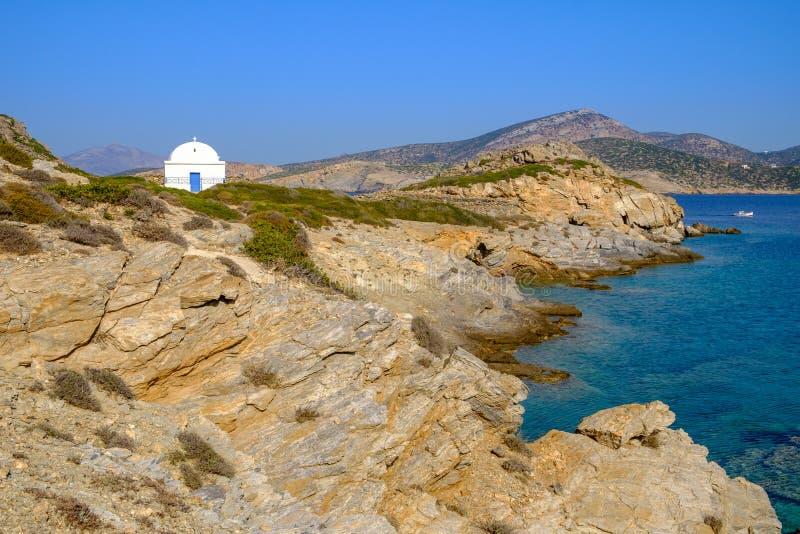 Scenic view of white chapel at beautiful ocean coastline, Greece stock photos