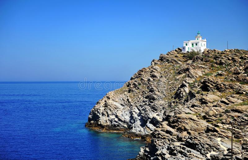 Scenic view of white lighthouse on cliffs. By sea. Beautiful natural seascape, Paros island, Greece stock photo