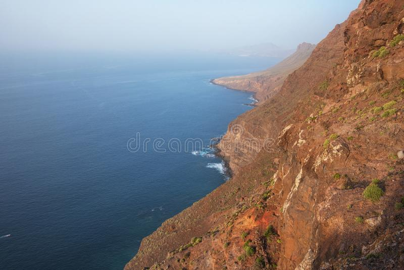 Scenic volcanic coastline landscape, Cliffs in Tamadaba natural park, Grand Canary island, Spain. royalty free stock photo