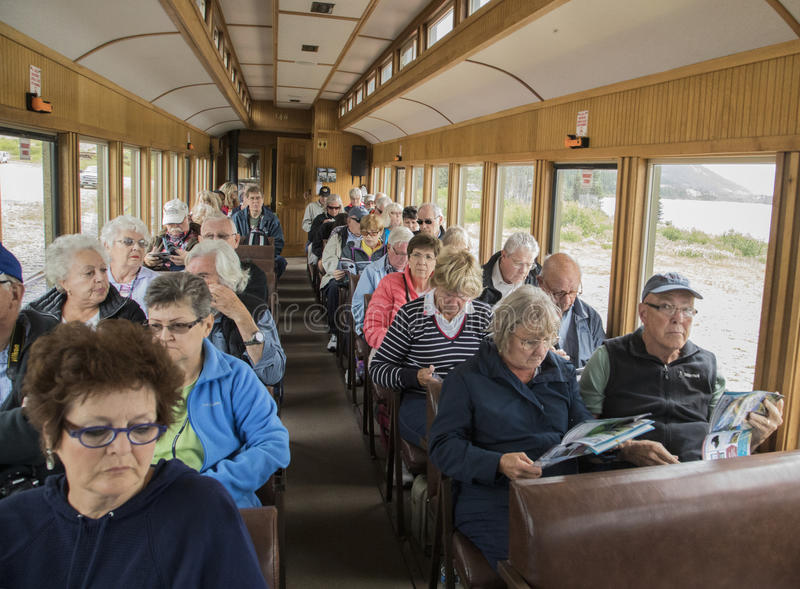 Scenic White Pass. Tourists enjoying their time aboard the White Pass & Yukon Route railroad which was built in 1898 concurrent with the Klondike gold rush in royalty free stock photography