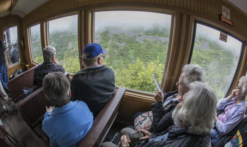 Scenic White Pass & Yukon Route. Tourists enjoying their time aboard the White Pass & Yukon Route railroad which was built in 1898 concurrent with the Klondike stock photo