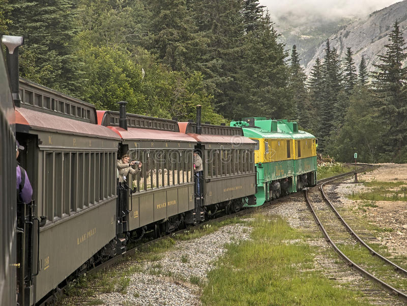 Scenic White Pass & Yukon Route. Tourists enjoying their time aboard the White Pass & Yukon Route railroad which was built in 1898 concurrent with the Klondike royalty free stock images
