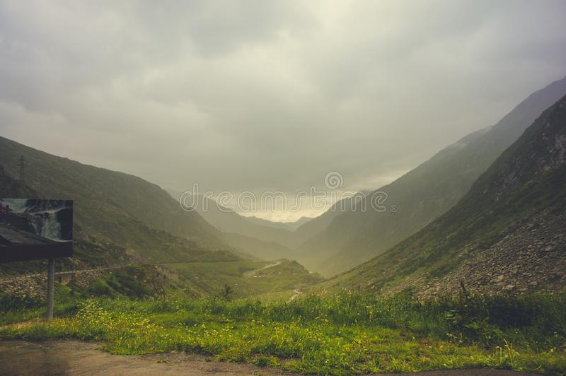 Scenic winding road in the foggy mountains of Switzerland royalty free stock image