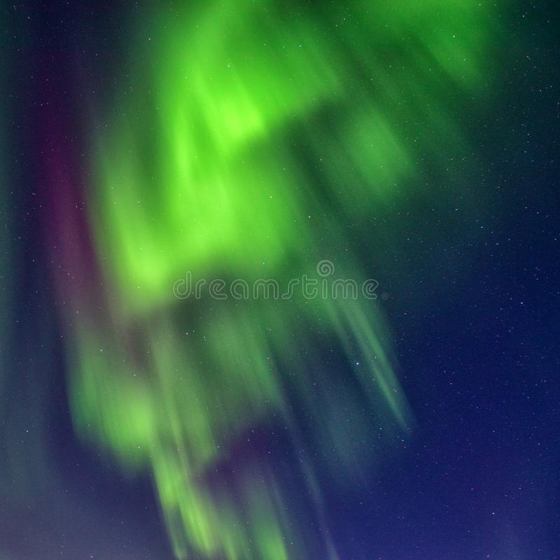 Scenic winter landscape with northern lights, Aurora borealis in night sky, Lofoten Islands, Norway royalty free stock photo