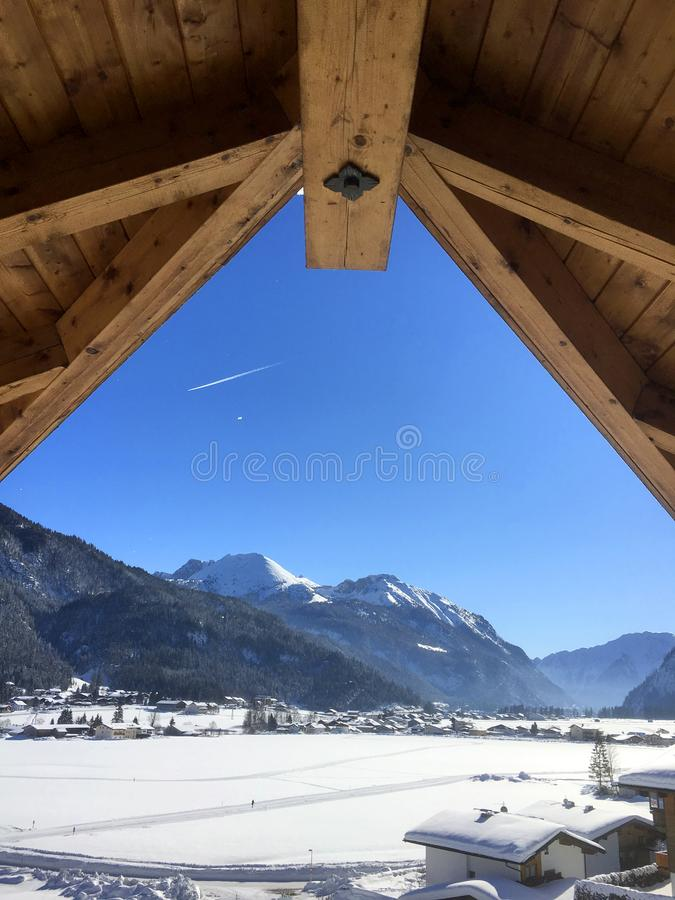 Scenic winter snow landscape in Tyrol, Austria seen from a window royalty free stock photography