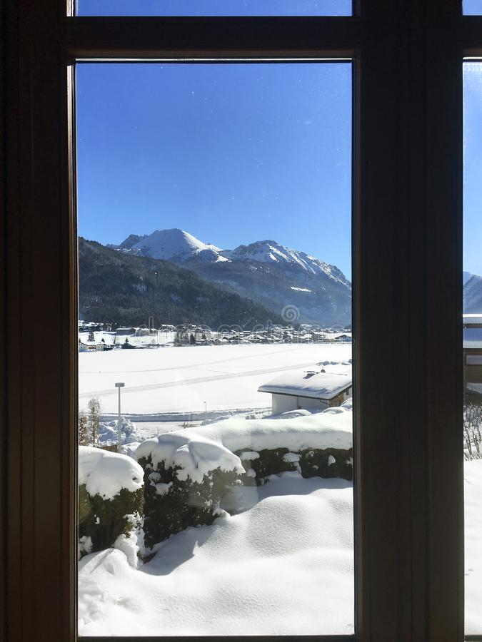 Scenic winter snow landscape in Tyrol, Austria seen from a window royalty free stock image
