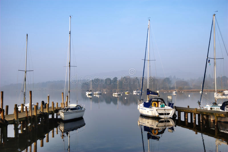 Scenic yacht moorings on a lake royalty free stock images