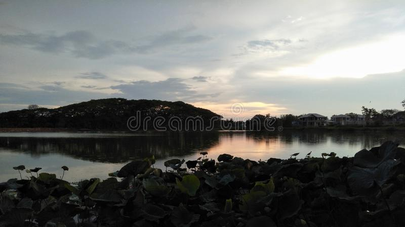 Scenics of lake with reflection of the evening sky. royalty free stock photos