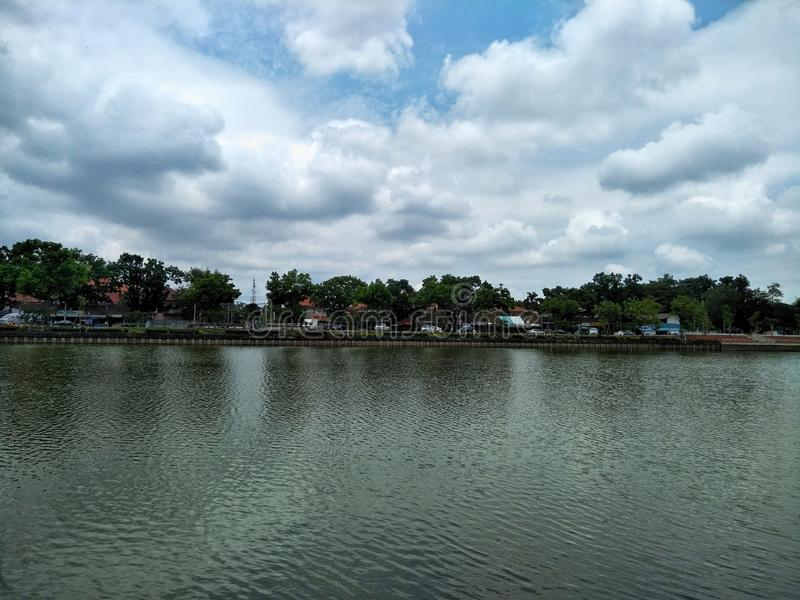 Scenics of lake and the sky with cloudy. Water, river, lakeside, e, natural, city, country, white, blue, background, weather, season, summer, environment, nong stock images
