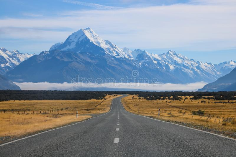 Sceninc road along Lake Pukaki goes all the way under the Southern Alps of New Zealand with the highest mountain Mt Cook, Aoraki stock images