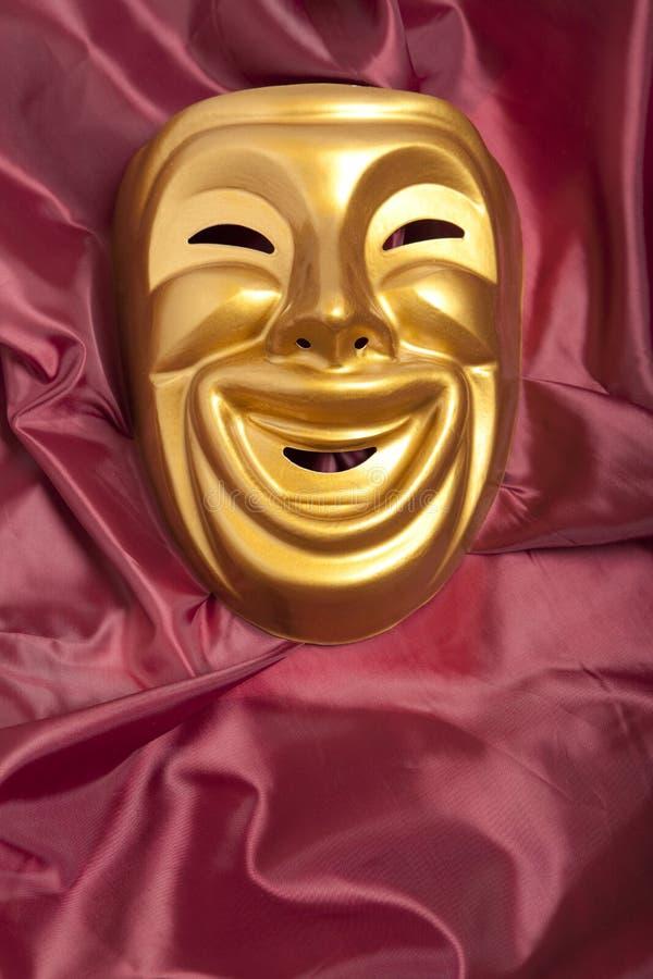 Scenisk maskering för guld- komedi arkivbild