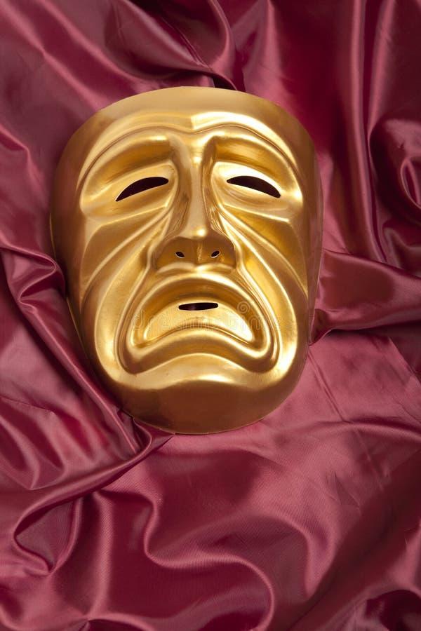 Scenisk maskering för guld- tragedi royaltyfri foto