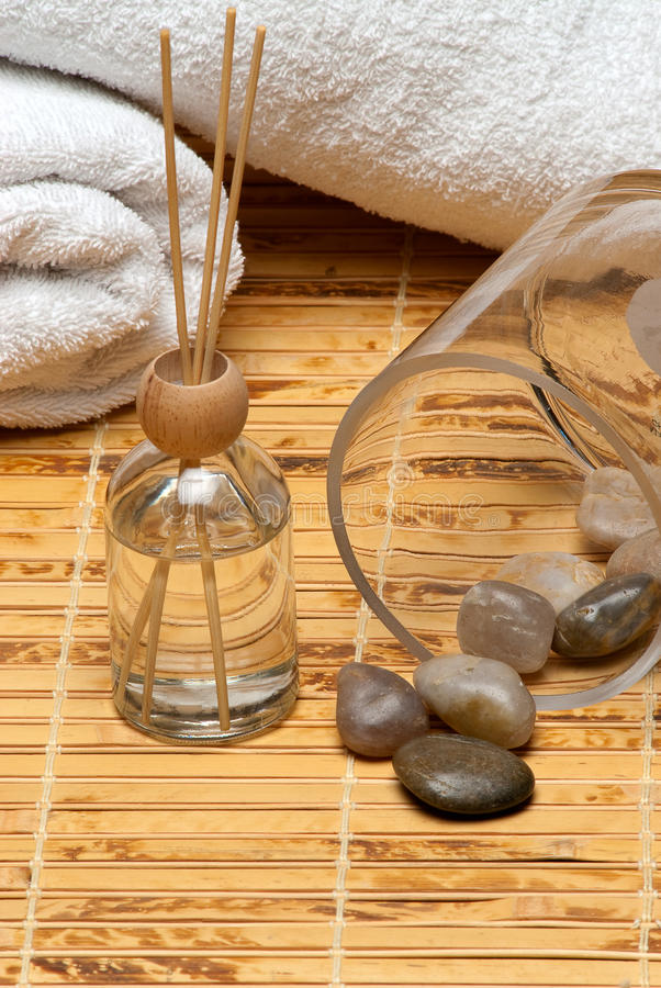 Download Scented Oil Diffuser With Towels On Bamboo Mat Stock Photo - Image: 12707206