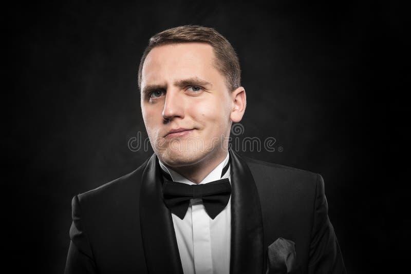 Sceptische zakenman in kostuum royalty-vrije stock foto