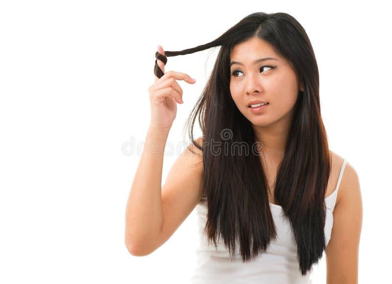 Schädigendes trockenes Haar stockfotografie