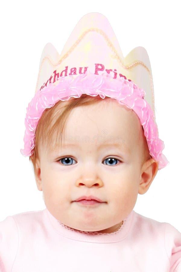 Schätzchen im Geburtstaghut stockbild