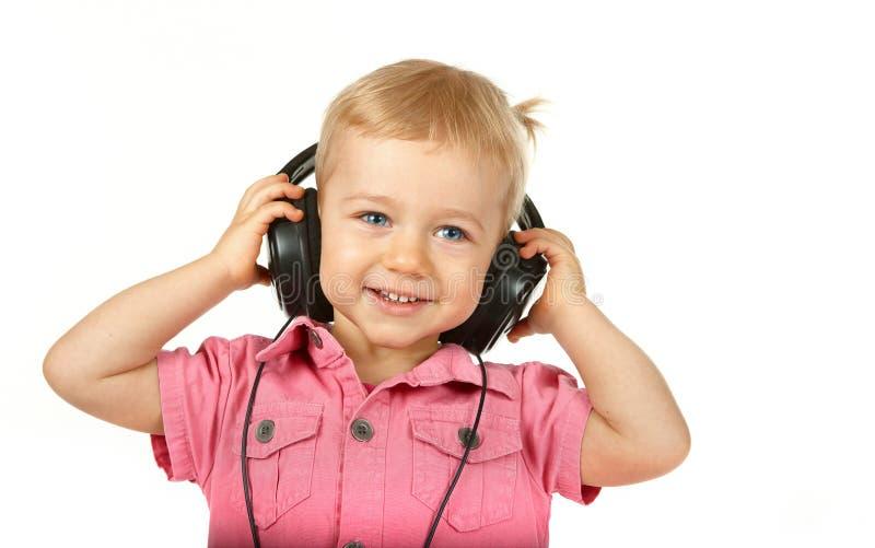 Schätzchen mit Kopfhörern lizenzfreie stockbilder