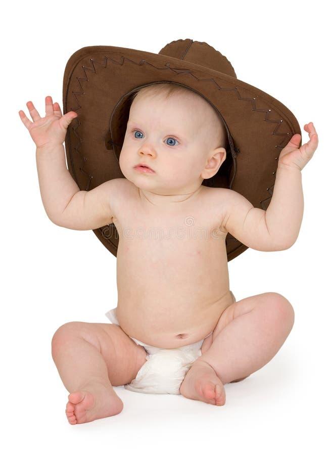 Schätzchen- und Cowboyhut auf weißem Hintergrund lizenzfreies stockbild
