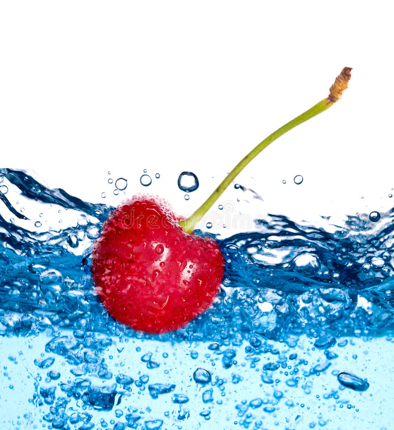 Schön spritzt ein Trinkwasser und eine Frucht lizenzfreie stockbilder