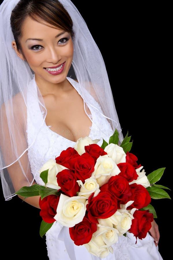 Schöne asiatische Braut an der Hochzeit lizenzfreie stockfotografie