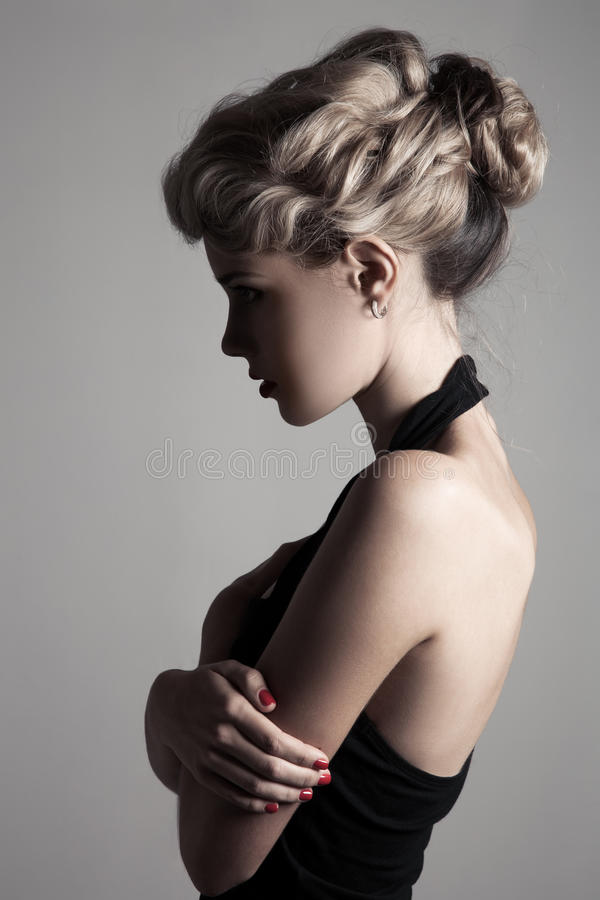Schöne Blondine. Retro- Mode-Bild. stockbilder