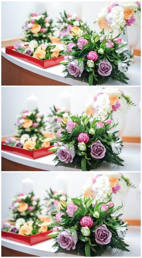 Schöne Blumensträuße von rosafarbenen Blumen, auf Tabelle Hochzeitsblumensträuße von verschiedenen Farbrosen Elegante Hochzeitsbl lizenzfreie stockbilder