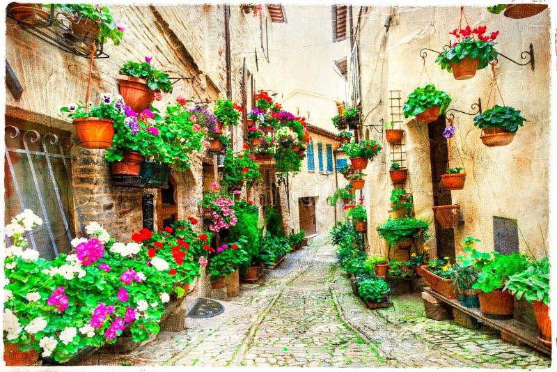 Schöne Blumenstraßen von Spello, Italien lizenzfreie stockbilder