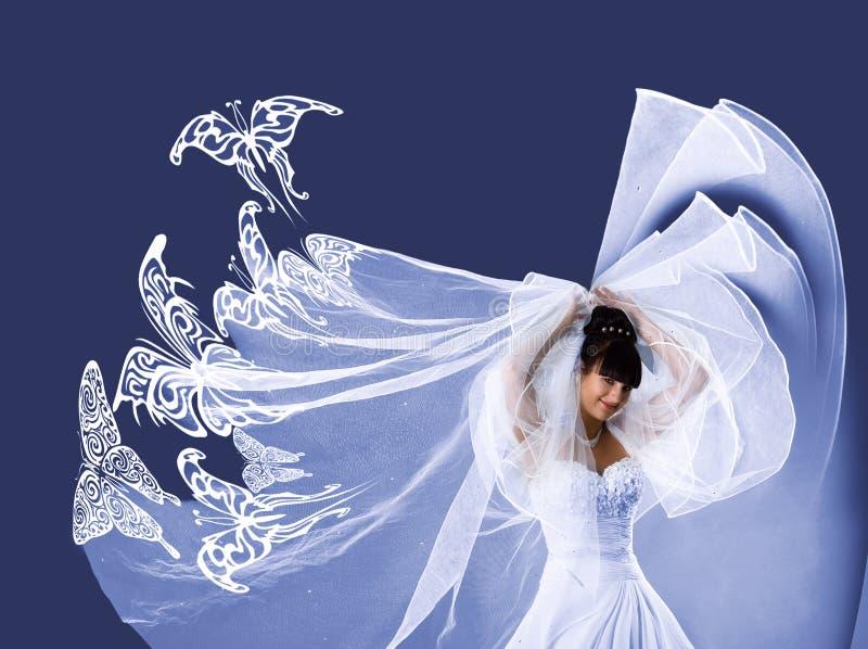 Schöne Braut in einem weißen Kleid mit Basisrecheneinheiten lizenzfreies stockfoto