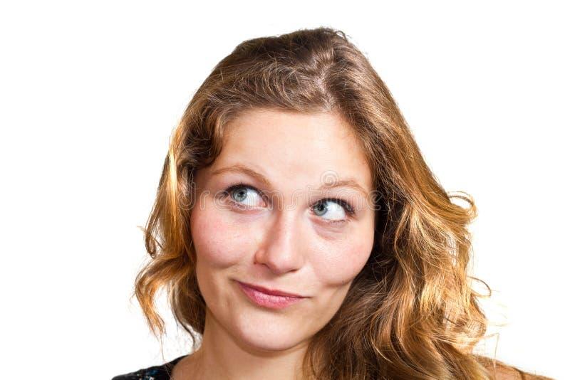 Schöne durchdachte Frau, die oben schaut stockfoto