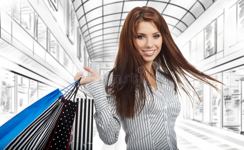 Schöne Einkaufenfrau stockbilder