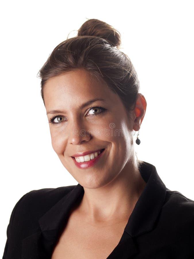 Schöne erfolgreiche Geschäftsfrau, die an Ihnen lächelt lizenzfreies stockbild