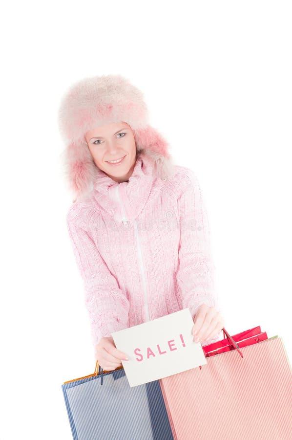 Schöne Frau in den rosafarbenen witsh Einkaufenbeuteln lizenzfreie stockfotos