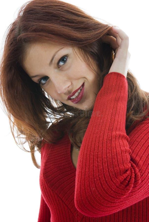 Schöne Frau in der roten Strickjacke stockfoto