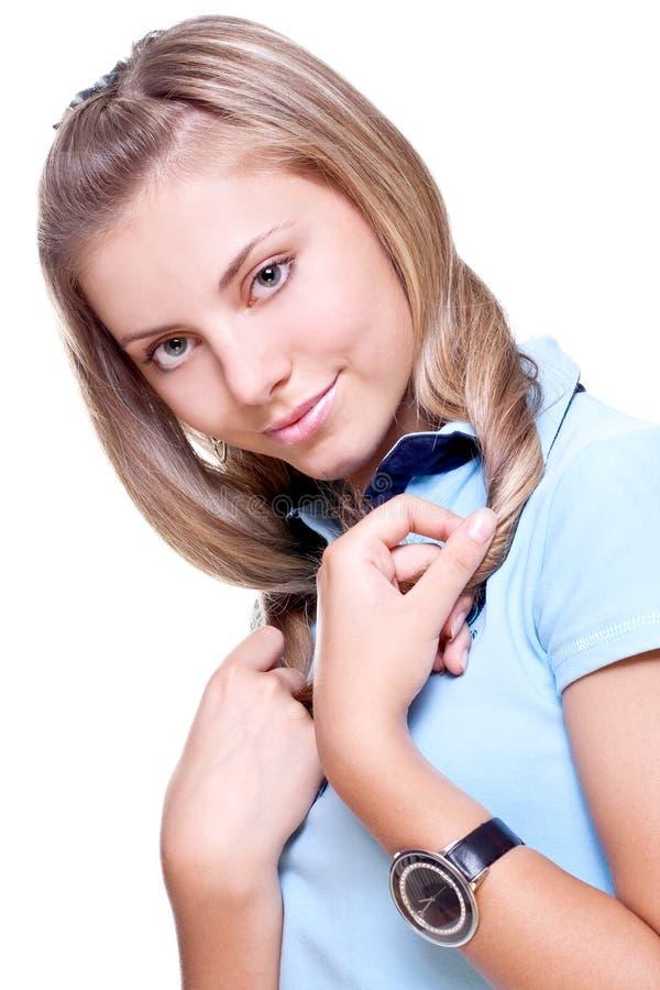 Schöne Frau in einem blauen T-Shirt lizenzfreies stockbild