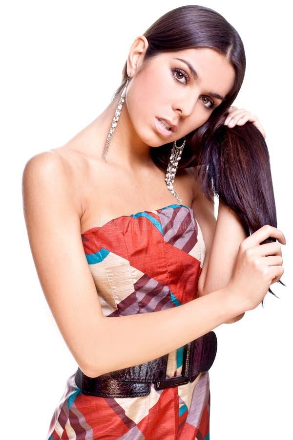 Schöne Frau in einem Kleid lizenzfreie stockbilder