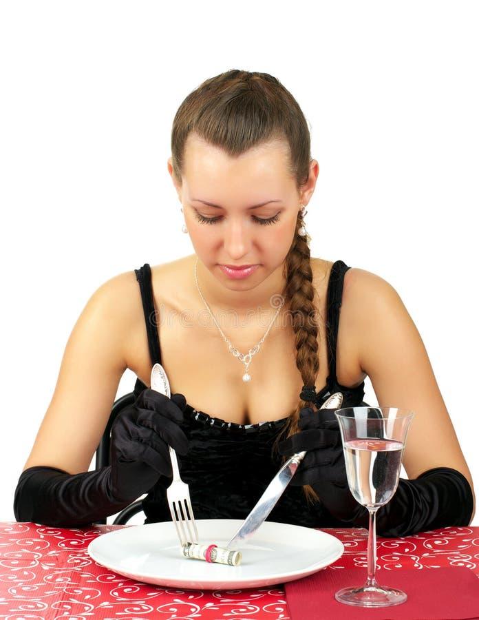 Schöne Frau essen zu Abend lizenzfreie stockbilder