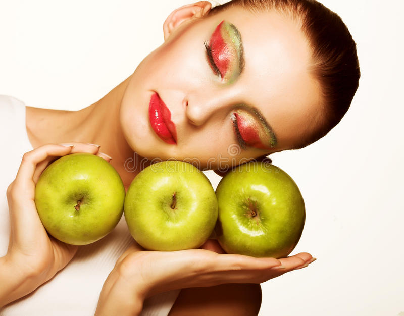 Schöne Frau mit Apfel stockbilder