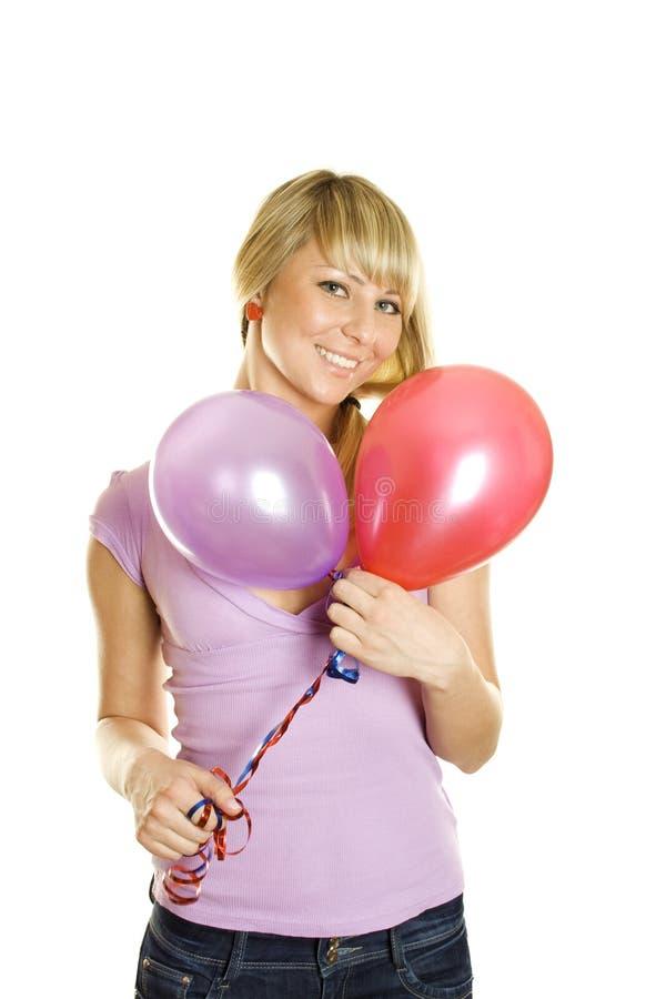 Schöne Frau mit Ballonen stockfoto