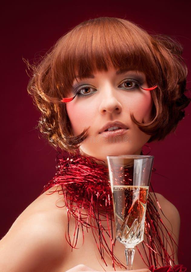 Schöne Frau mit Champagnerglas lizenzfreies stockbild