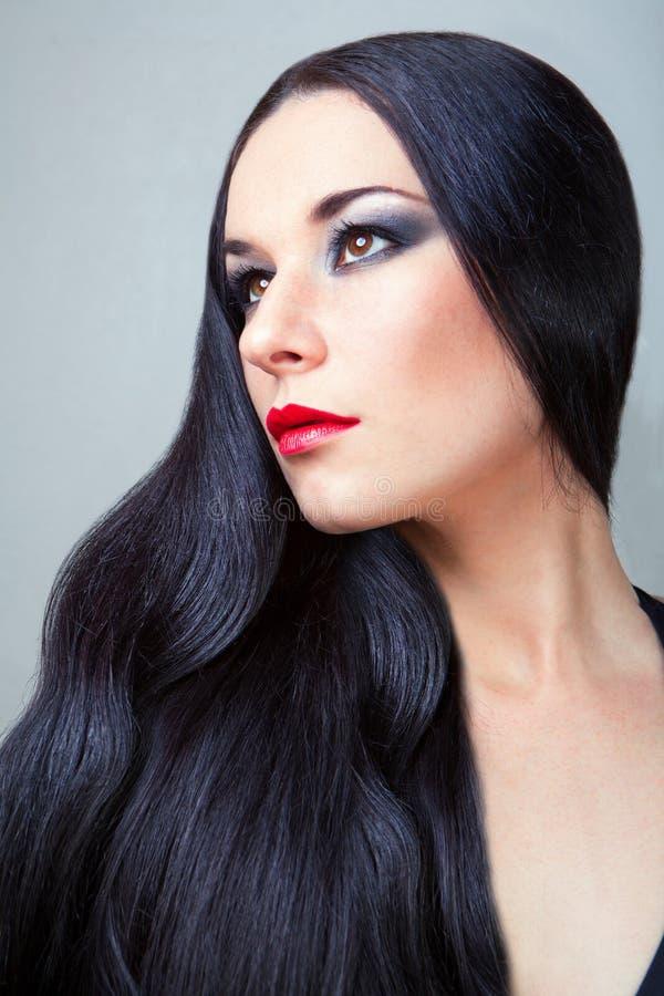 Schöne Frau mit den schönen langen Haaren lizenzfreie stockbilder