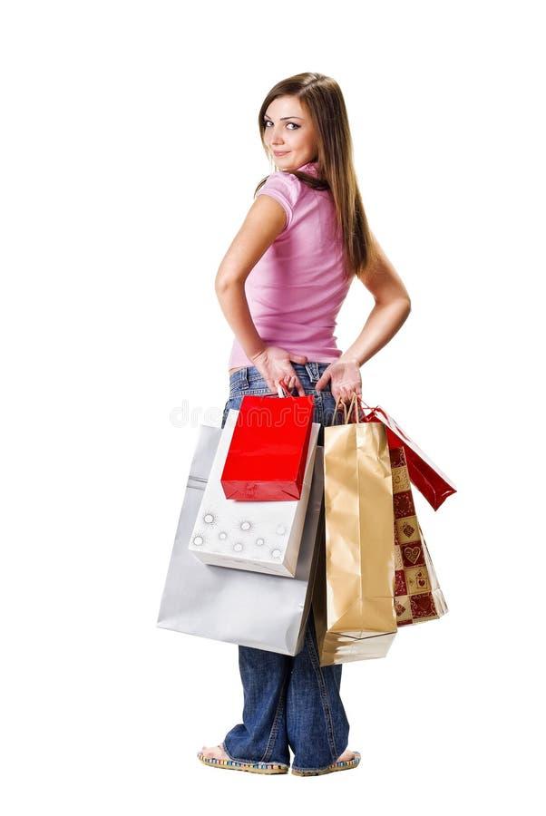 Schöne Frau mit Einkaufenbeuteln lizenzfreie stockfotografie