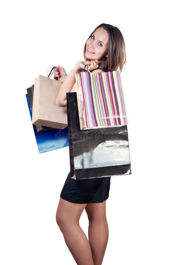 Schöne Frau mit Einkaufenbeuteln stockfotos