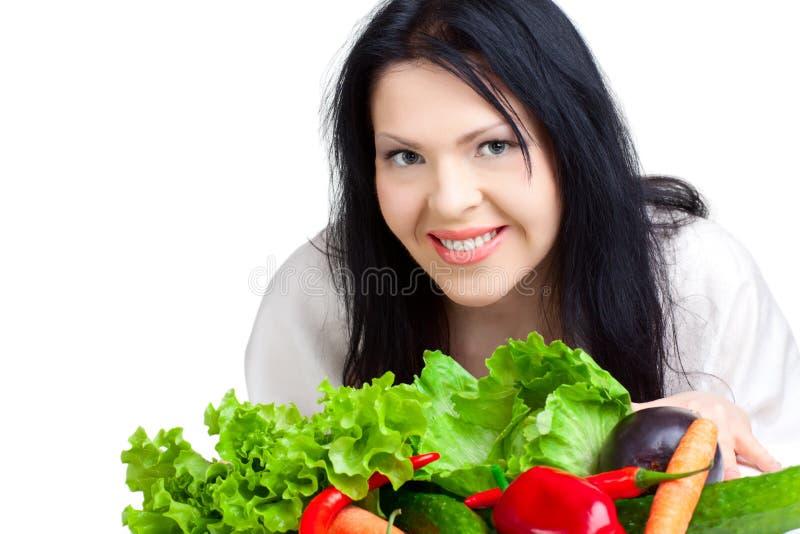 Schöne Frau mit Gemüse stockfotografie
