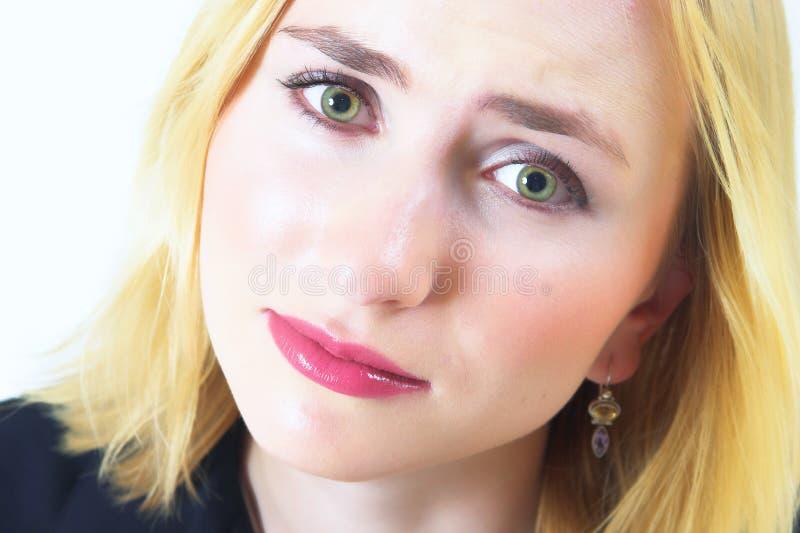 Schöne Frau mit traurigen Augen lizenzfreies stockfoto