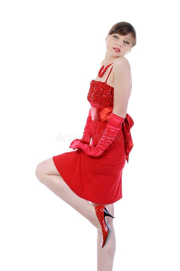 Schöne Frauen im roten Kleid. stockfotografie