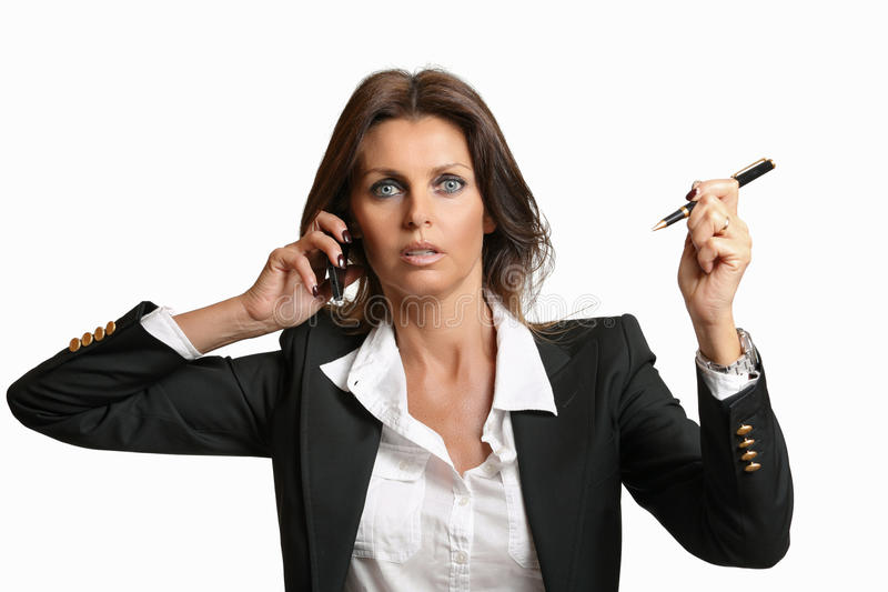 Schöne Geschäftsfrau beschäftigt bei der Arbeit lizenzfreies stockbild